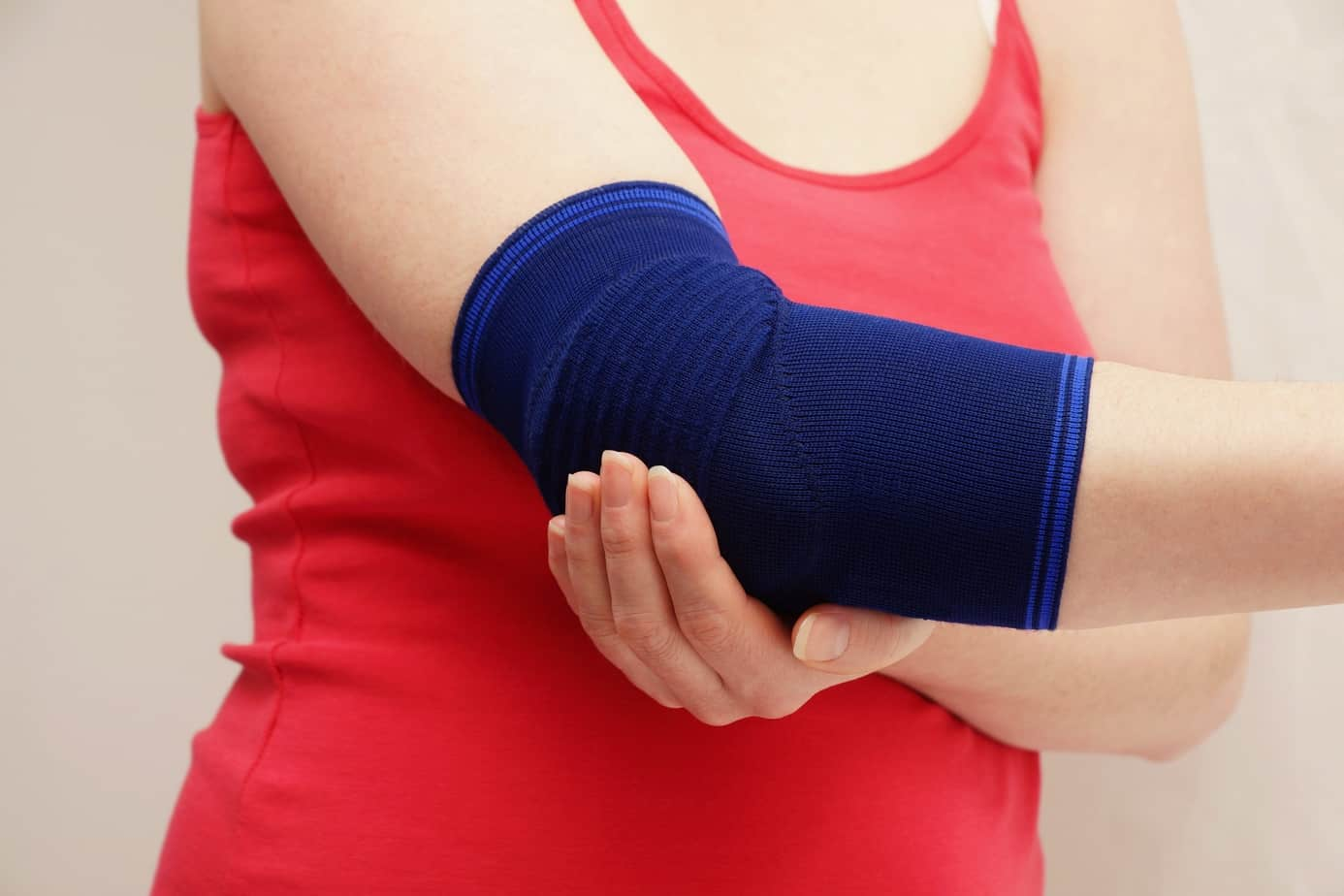 woman wearing elbow compression sleeve